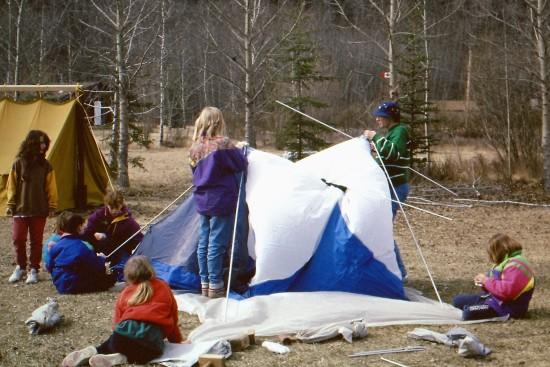 Girl guides raising tent