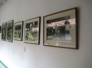 Reflections on framed photographs on a wall