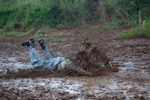 Man sliding in mud