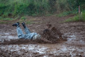 Man sliding in mud