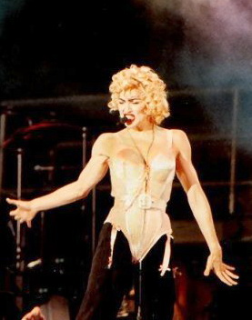 Madonna wearing bustier on stage