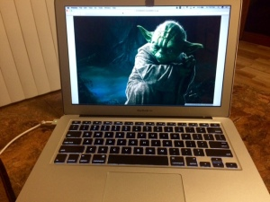 Master Yoda from Star Wars on a laptop