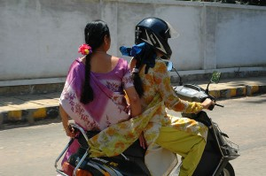 Two women riding a scooter