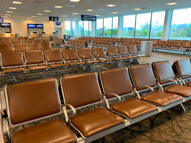 Waiting area for four gates at SJC. No people.
