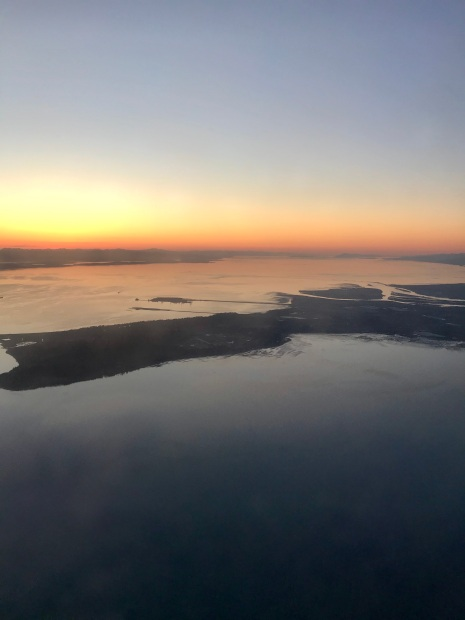 Arriving in Vancouver at sunset, looking towards the islands.