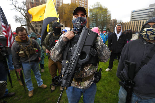Armed protesters. Photo by Jeff Kowalsky/AFP via Getty Images. From The Guardian.