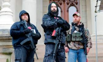 Armed Protesters byJeff Kowalsky/AFP via Getty Images from The Guardian