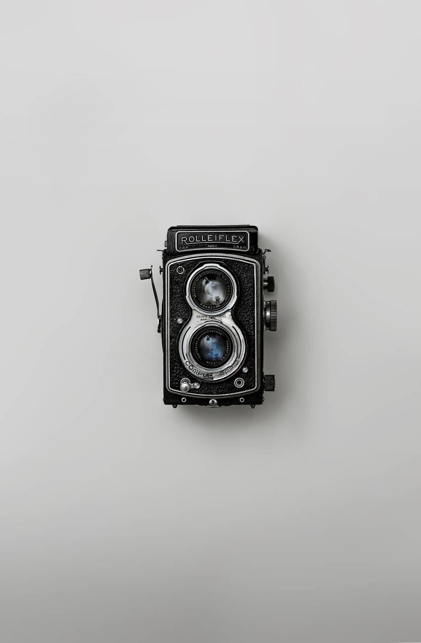 black rolleiflex reel to reel projector