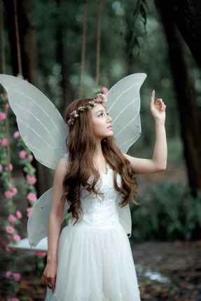 woman in fairy costume raising hand